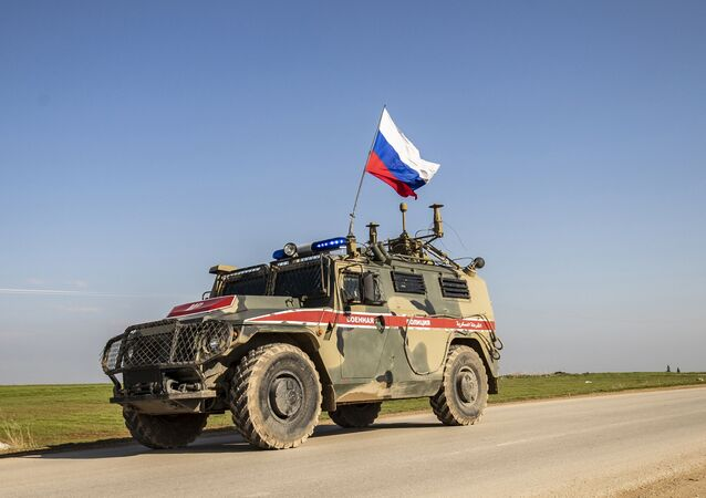 A Russian military police vehicle in the town of Darbasiyah in Syria's northeastern Hasakeh province along the Syria-Turkey border