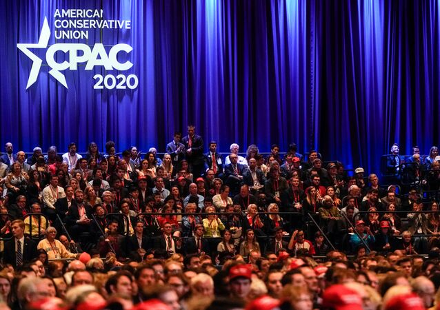 People listen at the Conservative Political Action Conference (CPAC) annual meeting at National Harbor in Oxon Hill, Maryland