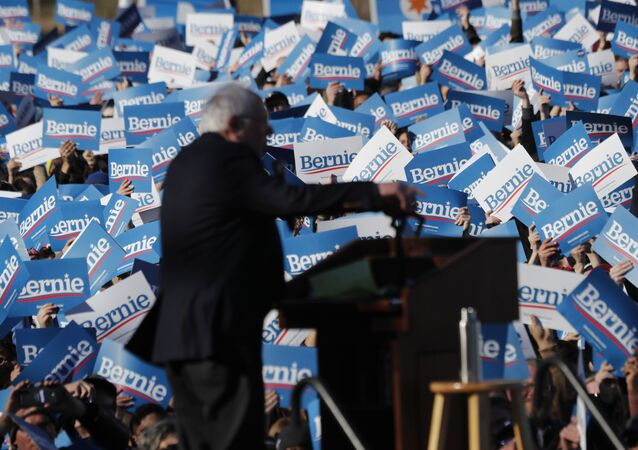 Supporters of Democratic presidential candidate Sen. Bernie Sanders, I-Vt., wave their campaign signs at a rally in Chicago's Grant Park Saturday, 7 March 2020.