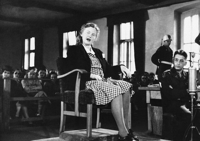 Ilse Koch, wife of the first commander of Buchenwald concentration camp, Dachau, Germany testifies on the witness stand in her own defense  July 8, 1947, in connection with the war crimes committee by her husband at the camp during the war.