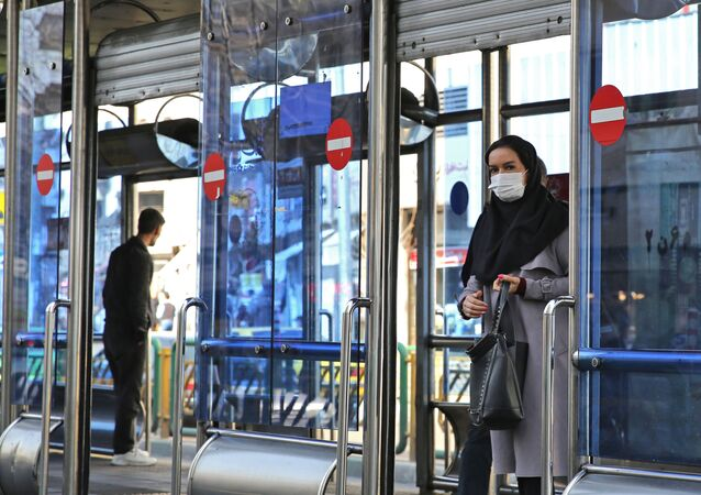 An Iranian woman wears a protective mask in the capital Tehran on March 4, 2020.