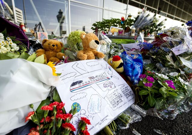 In this file photo taken on 31 July 2014 a drawing, flowers, candles and stuffed animals placed at Schiphol Airport, near Amsterdam, the Netherlands, in memory of the victims of the Malaysia Airlines flight MH17 crash in eastern Ukraine.