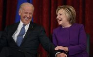 Vice President Joe Biden, left, laughs with former Secretary of State Hillary Clinton during a ceremony to unveil a portrait of Senate Minority Leader Harry Reid, D-Nev., on Capitol Hill, Thursday, Dec. 8, 2016, in Washington.