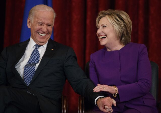 Vice President Joe Biden, left, laughs with former Secretary of State Hillary Clinton during a ceremony to unveil a portrait of Senate Minority Leader Harry Reid, D-Nev., on Capitol Hill, 8 December 2016, in Washington.