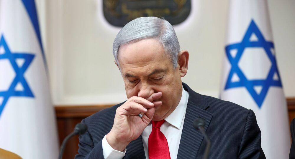 Israeli Prime Minister Benjamin Netanyahu gestures as he chairs the weekly cabinet meeting in Jerusalem, March 8, 2020.
