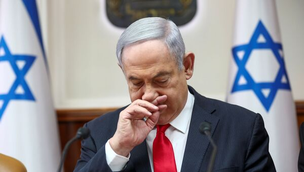 Israeli Prime Minister Benjamin Netanyahu gestures as he chairs the weekly cabinet meeting in Jerusalem, March 8, 2020. - Sputnik International