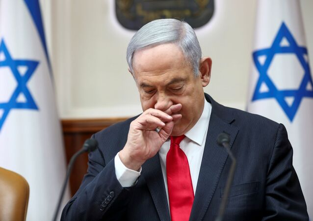 Israeli Prime Minister Benjamin Netanyahu gestures as he chairs the weekly cabinet meeting in Jerusalem, March 8, 2020.