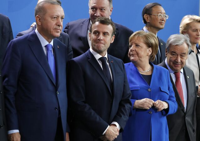 Turkish President Recep Tayyip Erdogan, French President Emmanuel Macron, German Chancellor Angela Merkel and Secretary-General of the United Nations (UN) Antonio Guterres wait prior to a family picture during a Peace summit on Libya at the Chancellery in Berlin, on January 19, 2020.