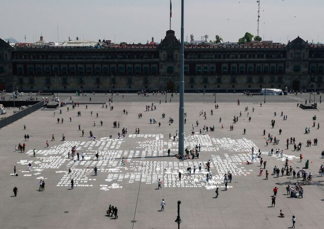 Women paint names of femicide victims during International Women's Day at Zocalo square, in Mexico City, Mexico March 8, 2020
