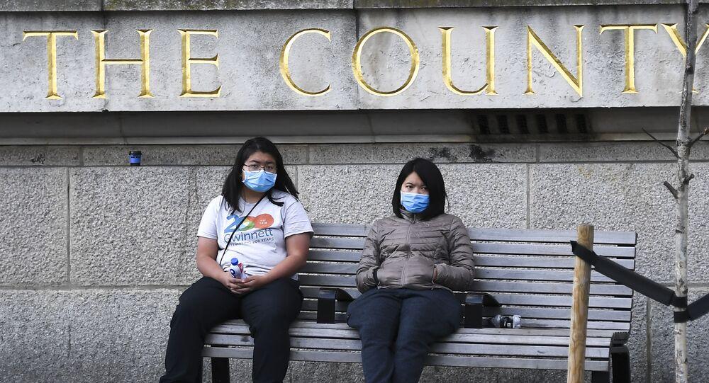 Two women wearing face masks in London