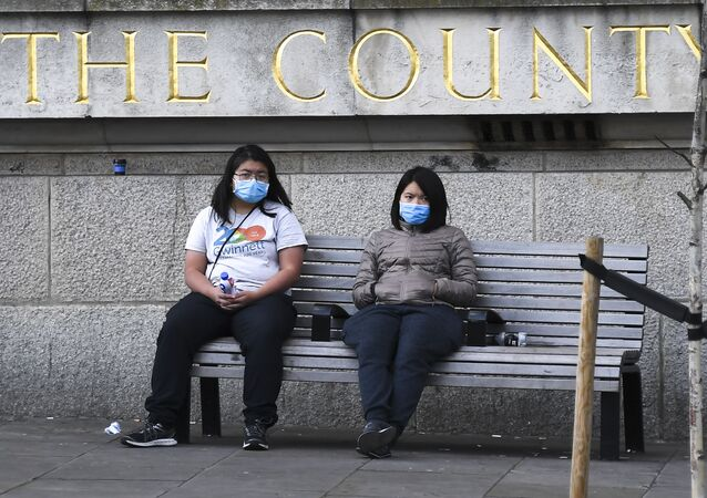 Two women wearing face masks in London