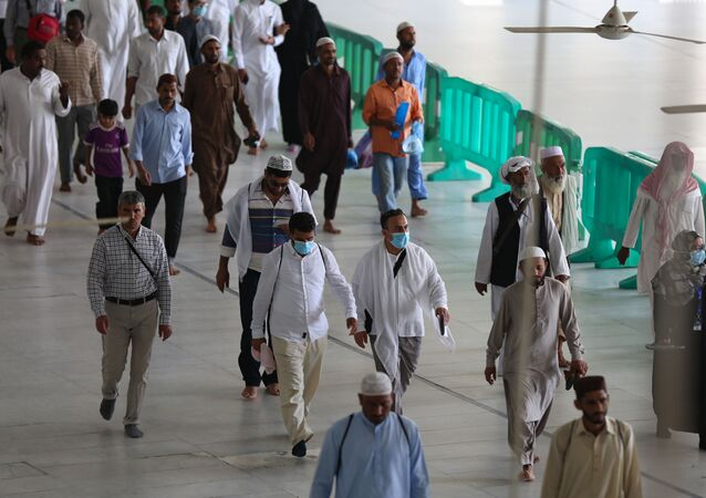 Worshippers with protective masks around  Mecca's Grand Mosque