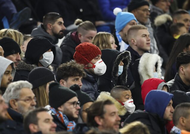 Supporters with protective masks at the Velodrome stadium in Marseille