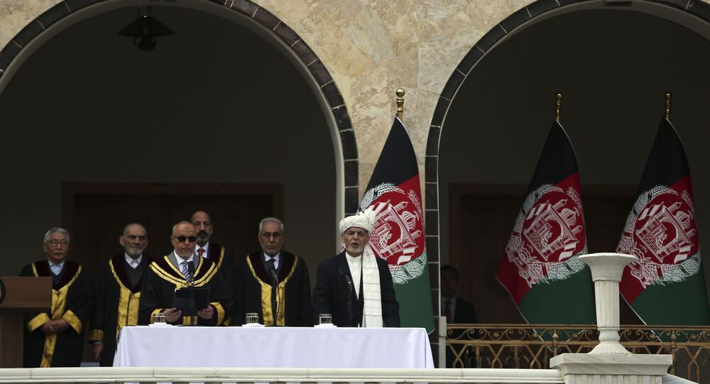 Afghan President Ashraf Ghani, right, is sworn in by Chief Justice Sayed Yousuf Halim, during his inauguration ceremony at the presidential palace in Kabul, Afghanistan, Monday, March 9, 2020