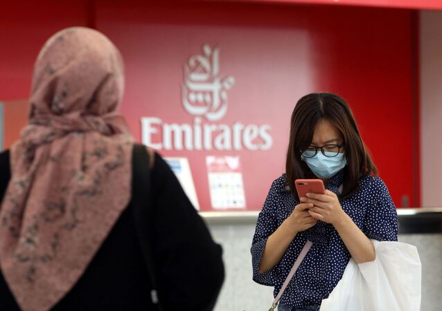 FILE PHOTO: A traveller wears a mask at Dubai International Airport, after the UAE's Ministry of Health and Community Prevention confirmed the country's first case of coronavirus, in Dubai, United Arab Emirates January 29, 2020.