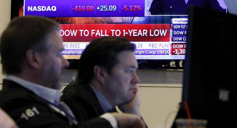A television screen headlines news as traders prepare for the day's activity on the floor of the New York Stock Exchange, Monday, March 9, 2020. Trading in Wall Street futures has been halted after they fell by more than the daily limit of 5%.