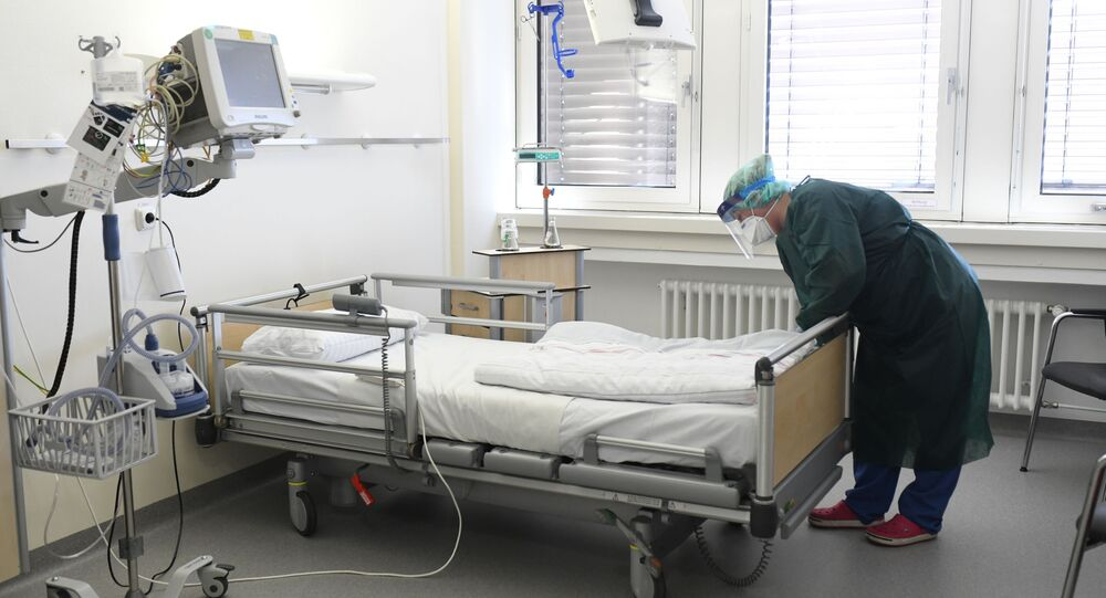Nurse Canan Emcan checks a bed in a room at the isolation ward of the Uniklinikum Essen university hospital in Essen, western Germany, on March 9, 2020.