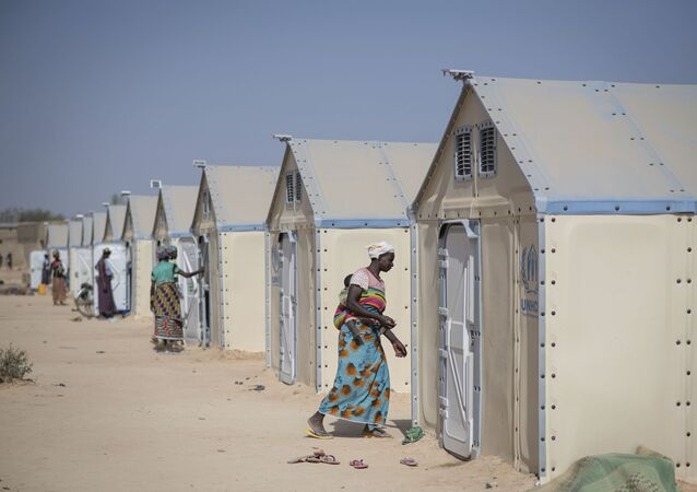 In this photo taken on Tuesday, Dec. 10, 2019 displaced Burkinabe people in the Pissila town camp, near Kaya, Burkina Faso. Islamic extremists carried out a record number of attacks last year in Burkina Faso and the instability has now spread to the country's east. The violence in northern and now eastern Burkina Faso has displaced more than half a million people, according to the United Nations. And there are fears the unrest could throw elections planned for late 2020 into question.
