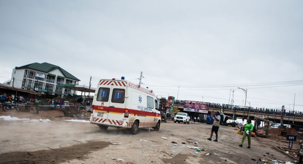 An ambulance drives near the site of an explosion in Accra on October 8, 2017 a day after a gas tanker caught fire, triggering explosions at two fuel stations. - At least three people were killed and dozens injured after a tanker truck carrying natural gas caught fire in Ghana's capital, Accra, triggering explosions at two fuel stations, emergency services said on October 8, 2017.
