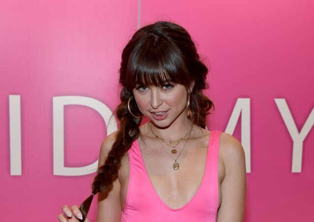 Adult film actress Riley Reid poses at the Reid My Lips booth at the 2020 AVN Adult Entertainment Expo at the Hard Rock Hotel & Casino on January 22, 2020 in Las Vegas, Nevada.