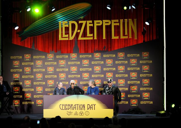 Led Zeppelin, from left, bassist/keyboardist John Paul Jones, guitarist Jimmy Page, singer Robert Plant, and drummer Jason Bonham participate in a press conference ahead of the worldwide theatrical release of Celebration Day, a concert film of their 2007 London O2 arena reunion show, at the Museum of Modern Art on Tuesday, Oct. 9, 2012 in New York.