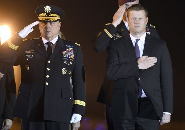 Army Chief of Staff Gen. Mark Milley, left, and Secretary of the Army Ryan McCarthy, stand as an Army carry team, not pictured, moves a transfer case containing the remains of Spc. Michael I. Nance at Dover Air Force Base, Del., on Wednesday, July 31, 2019.