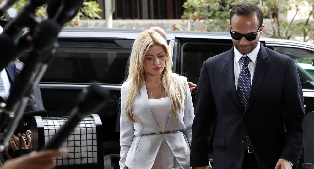 Former Donald Trump presidential campaign foreign policy adviser George Papadopoulos, right, who pleaded guilty to one count of making false statements to the FBI during the agency's Russia probe, holds hands with his wife Simona Mangiante, as they arrive at federal court for sentencing, Friday, Sept. 7, 2018, in Washington.