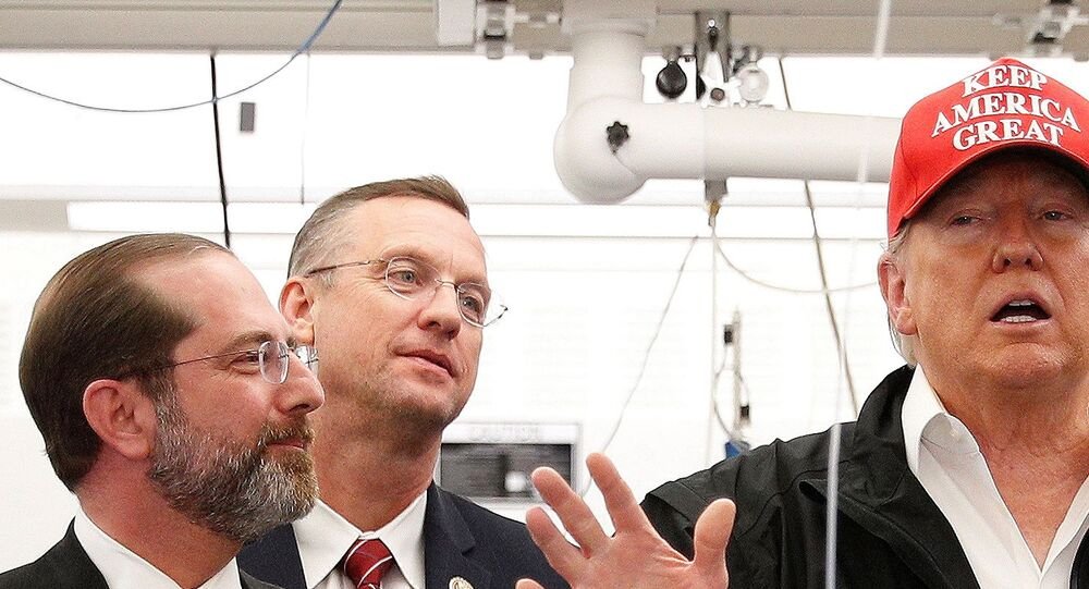 U.S. President Donald Trump delivers remarks beside HHS Secretary Alex Azar and Rep. Doug Collins (R-GA) during a tour of the Center for Disease Control in Atlanta