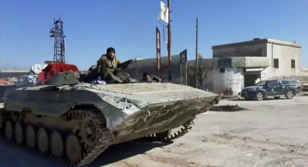 A still image taken from a video obtained by Reuters and shot on March 2, 2020, shows Syrian army soldiers advancing on the town of Kfar Nabl