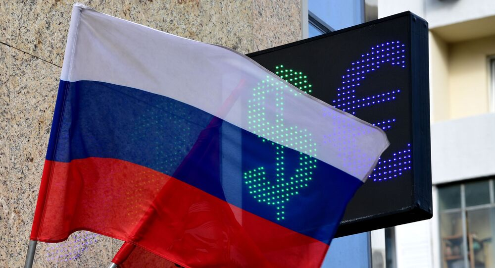 Signs of euro and dollar on the board of exchange rates in Moscow