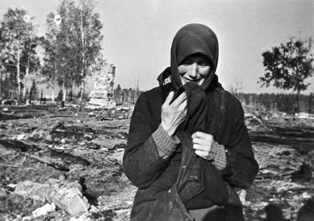 Woman weeping on the ruins of her native village burnt by the Nazis in the second world war