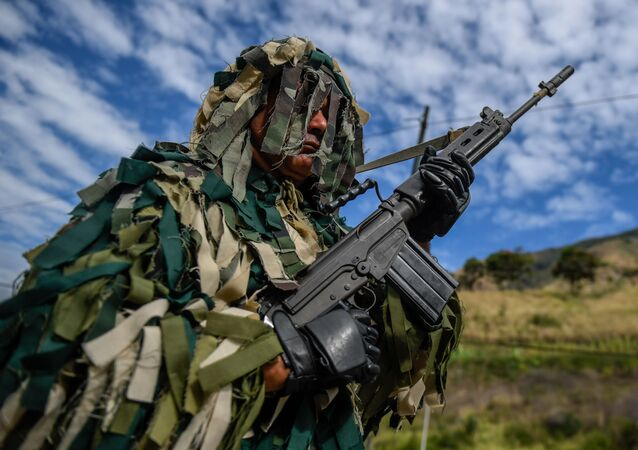 A member of the National Guard takes part in military exercises for the 'Bolivarian Shield 2020 Operation' at Metropolitan distributor in Caracas, on February 15, 2020