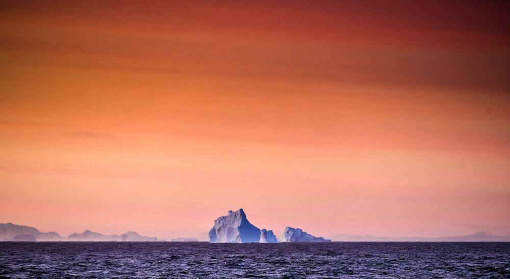 View of an iceberg from the Baltic Admiral Vladimirsky research vessel in the area of Alexander I Land during a voyage to the Bellingshausen Antarctic station.