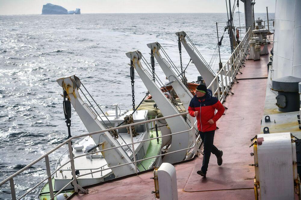 A team member runs on board the Admiral Vladimirsky