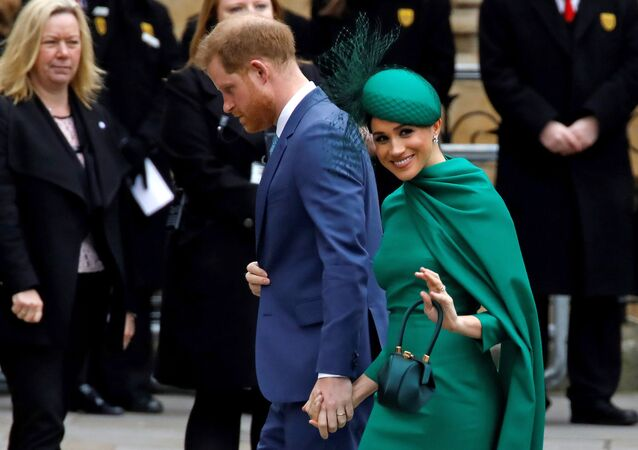 Britain's Prince Harry, Duke of Sussex, (L) and Meghan, Duchess of Sussex arrive to attend the annual Commonwealth Service at Westminster Abbey in London on 9 March 2020.