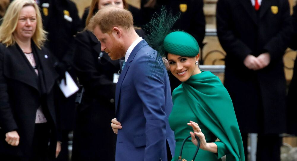 Britain's Prince Harry, Duke of Sussex, (L) and Meghan, Duchess of Sussex arrive to attend the annual Commonwealth Service at Westminster Abbey in London on March 09, 2020.
