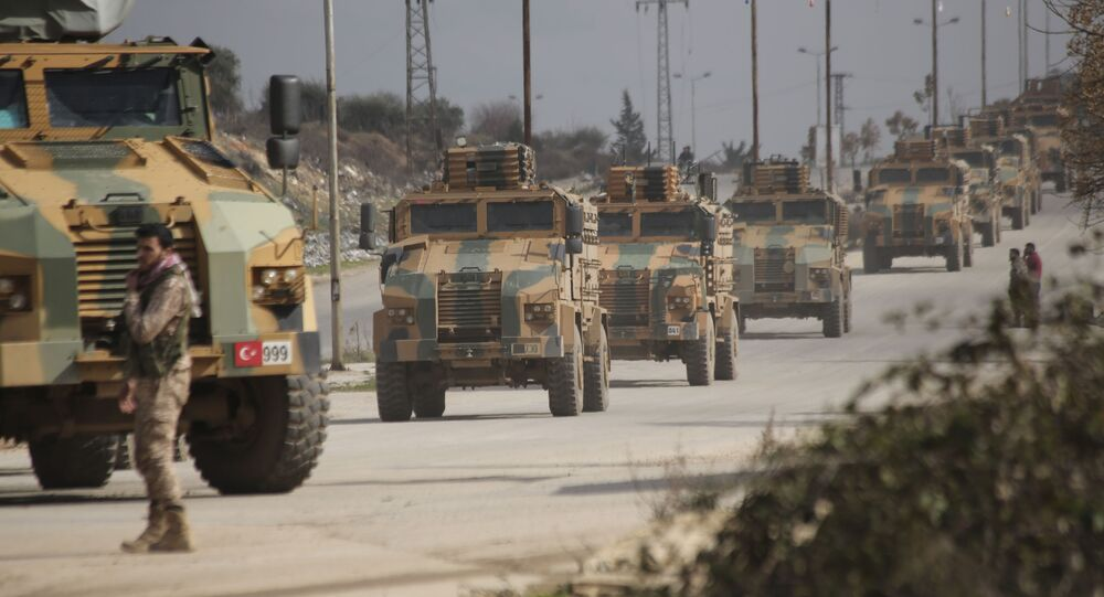FILE - In this 22 February 2020 file photo, a Turkish military convoy moves in Idlib province, Syria