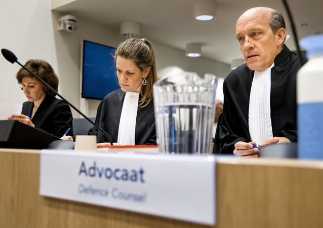 Sabine ten Doesschate (C) and Boudewijn van Eijck (R) lawyers of suspect Oleg Pulatov sit in the courtroom at the Schiphol Judicial Complex, on March 10, 2020 on the second day of the trial of four men accused of murder over the downing of Malaysia Airlines flight MH17 in 2014