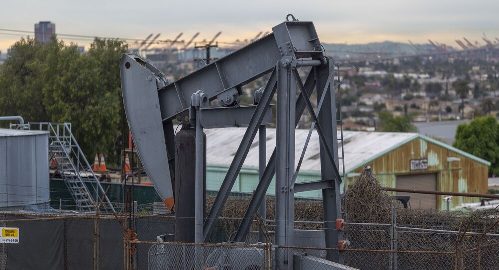 Pump jacks draw crude oil from the Long Beach Oil Field in Signal Hill, California, on March 9, 2020.