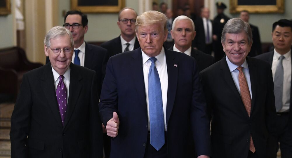 President Donald Trump gives a thumbs up as he walks with Senate Majority Leader Mitch McConnell of Ky., left, Treasury Secretary Steven Mnuchin, second from left, Vice President Mike Pence, and Sen. Roy Blunt, R-Mo., right, on Capitol Hill in Washington, Tuesday, March 10, 2020. (AP Photo/Susan Walsh)