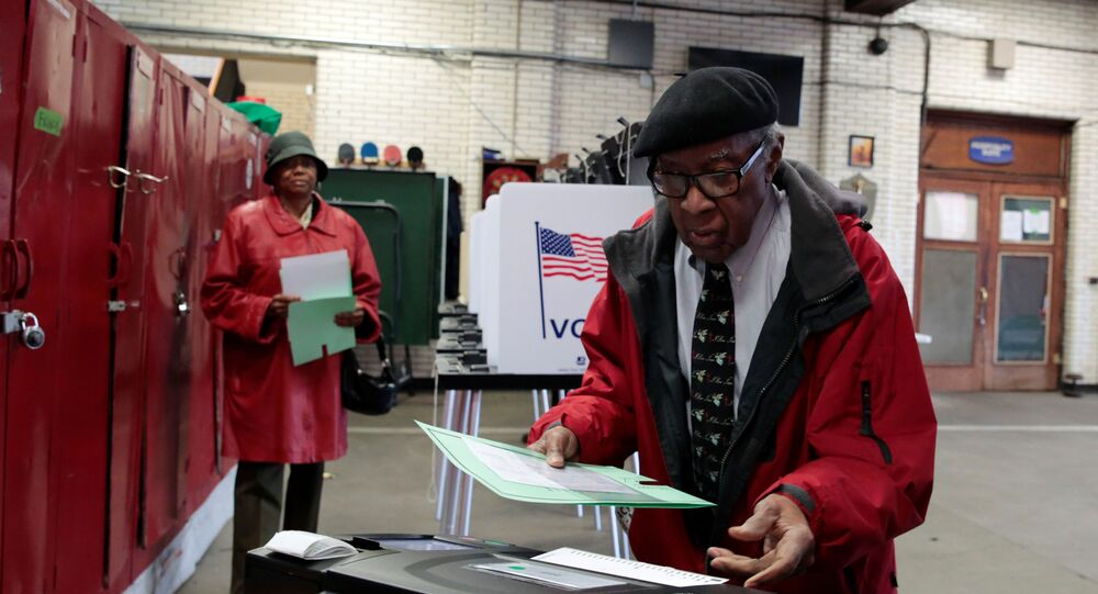 Voters cast their ballots in the Democratic primary election in Detroit, Michigan, U.S., March 10, 2020.