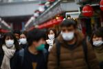 Tourists wearing protective face masks, following an outbreak of the coronavirus disease (COVID-19), visit Asakusa neighbourhood in Tokyo, Japan March 8, 2020