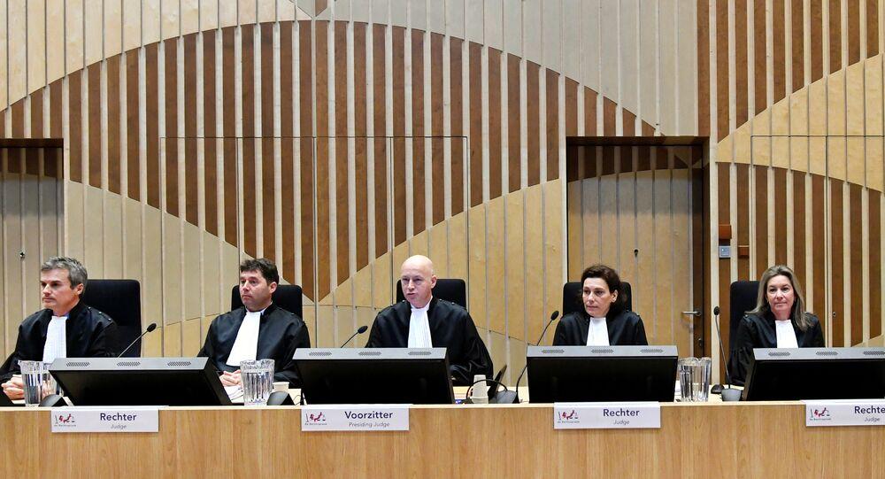 Judges attend the criminal trial against four suspects