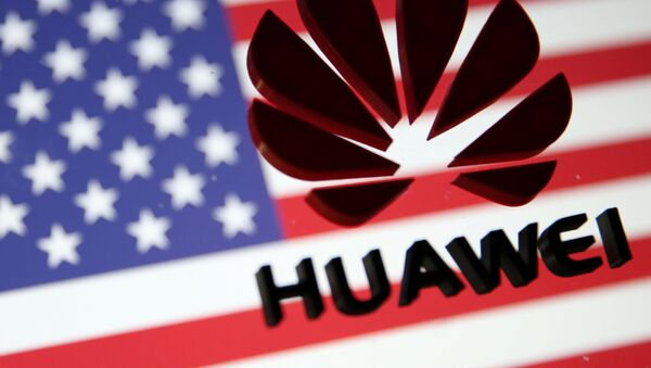A 3D printed Huawei logo is placed on glass above displayed US flag in this illustration taken January 29, 2019. - Sputnik International