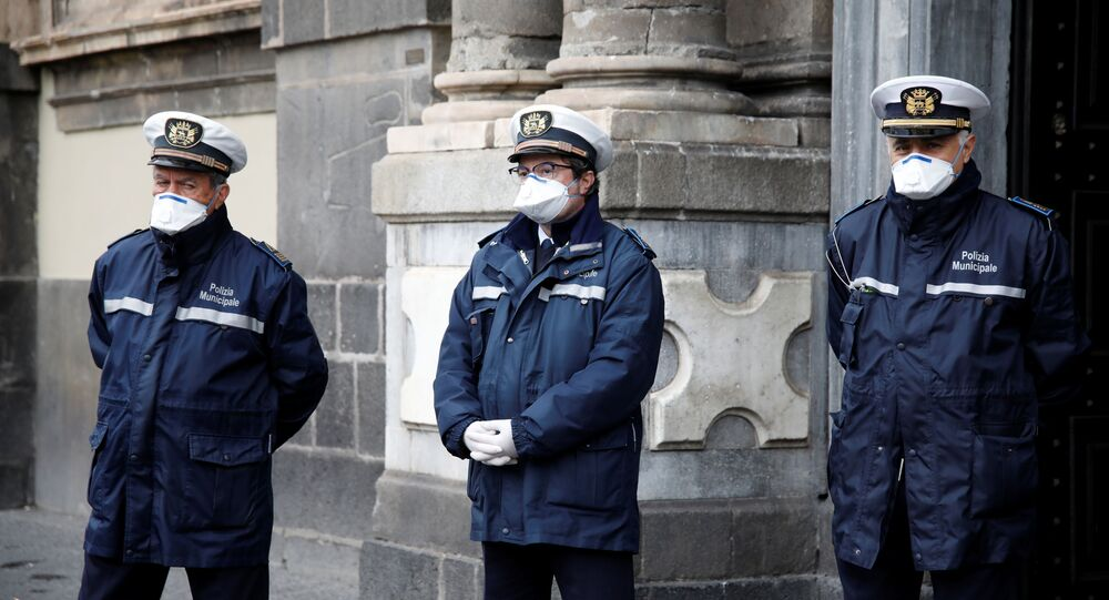 Policemen are seen on Duomo square after a decree orders for the whole of Italy to be on lockdown
