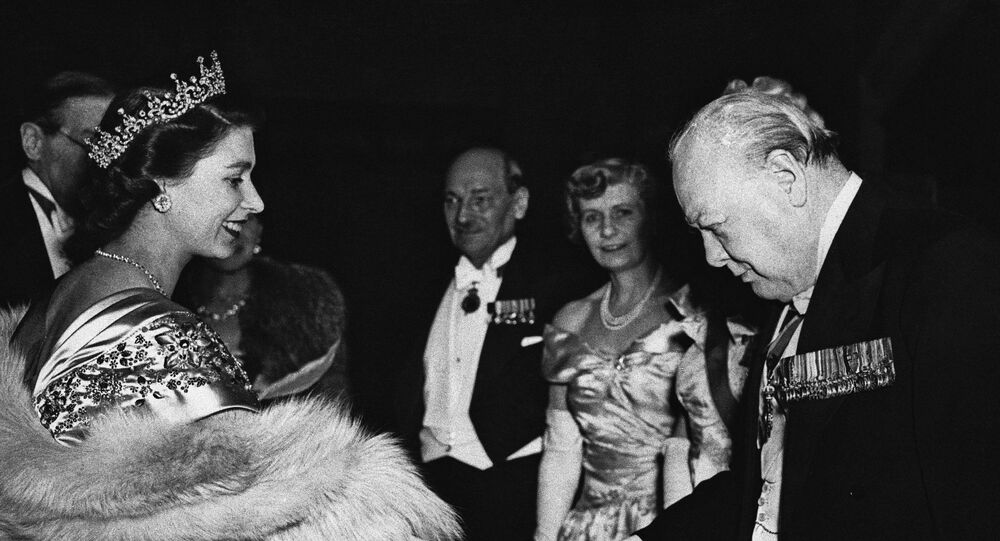 Smiling Princess Elizabeth extends her hand in greeting to Winston Churchill, former British Prime Minister, at a dinner in London, on March 22, 1950 to mark the launching of the Lord Mayor's National Thanksgiving Fund