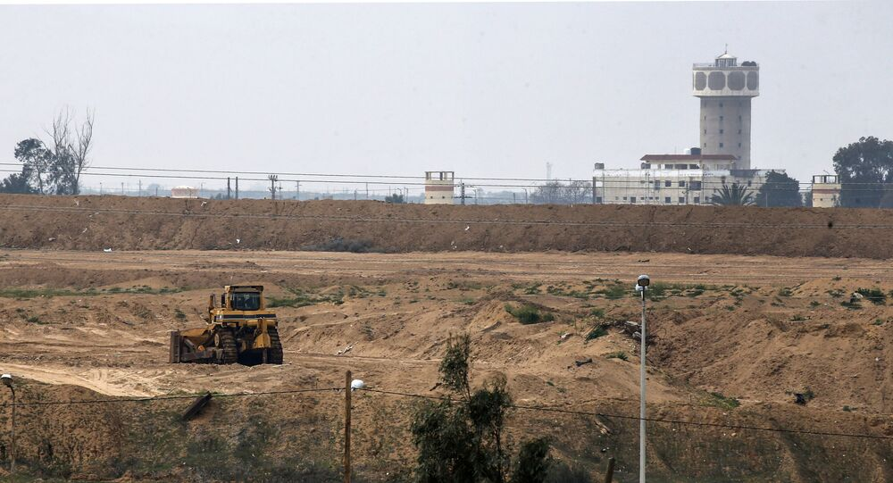 A picture taken in Rafah in the southern Gaza Strip at the border with Egypt shows an excavator at the construction site of a wall on the Egyptian side of the border on February 19, 2020.