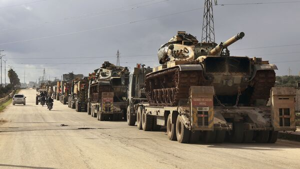 Turkish military convoy drives through the village of Binnish, in Idlib province, Syria, Saturday, Feb. 8, 2020 - Sputnik International