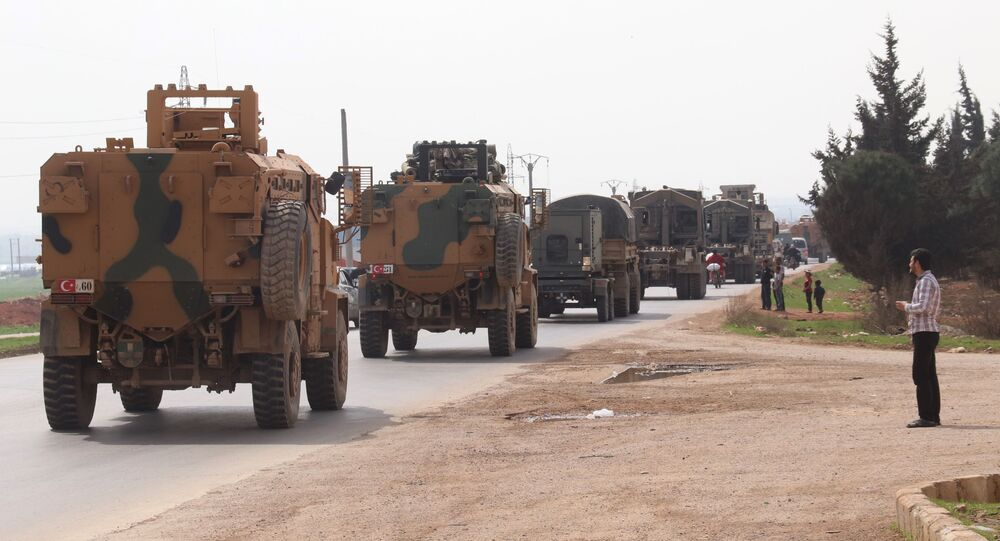 A Turkish military convoy drives near the Syrian town of Kefraya on the highway linking the northwestern Syrian province of Idlib to the Bab al-Hawa border crossing with Turkey, on March 10, 2020