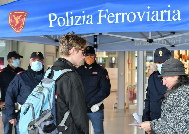 Police perform control checks on passengers at the Santa Lucia railway station in Venice on March 10, 2020, after Italy imposed unprecedented national restrictions on its 60 million people Tuesday to control the deadly COVID-19 coronavirus.